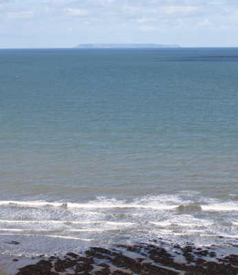 A distant view of Lundy from Peppercombe Beach