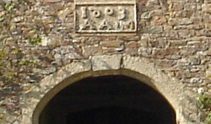 Plaque above door of Tetcott House